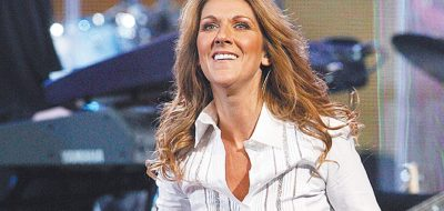Celine Dion performs at Caesars Palace hotel-casino in Las Vegas on Monday, Feb. 20, 2006, to raise funds for the hurricane-affected employees of Harrah's Entertainment Inc. Celine Dion and Elton John performed together for the first time. The concert raised $2.1 million. (AP Photo/Jae C. Hong)