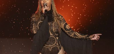 "FILE - In this June 26, 2016, file photo, Beyonce performs ""Freedom"" at the BET Awards in Los Angeles. Beyonce released a surprise single Sept. 28, 2017, on which she sings in Spanish, English and French to raise relief money for those affected by hurricanes in the Caribbean and earthquakes in Mexico. (Photo by Matt Sayles/Invision/AP, File)"