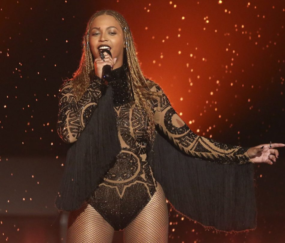 """FILE - In this June 26, 2016, file photo, Beyonce performs """"Freedom"""" at the BET Awards in Los Angeles. Beyonce released a surprise single Sept. 28, 2017, on which she sings in Spanish, English and French to raise relief money for those affected by hurricanes in the Caribbean and earthquakes in Mexico. (Photo by Matt Sayles/Invision/AP, File)"""