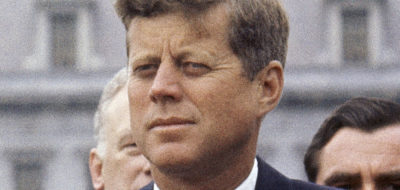 FILE - In this April 30, 1963 file photo, President John F. Kennedy listens while Grand Duchess Charlotte of Luxembourg speaks outside the White House in Washington. The National Archives has until Oct. 26, 2017, to disclose the remaining files related to Kennedy's Nov. 22, 1963 assassination, unless President Donald Trump intervenes. (AP Photo/William J. Smith, File)