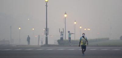 Morning walkers exercise amidst smog due to firecrackers burnt in Thursday's Diwali festival, in New Delhi, India, Friday, Oct. 20, 2017. Environmental pollution - from filthy air to contaminated water - is killing more people every year than all war and violence in the world. One out of every six premature deaths in the world in 2015 - about 9 million - could be attributed to disease from toxic exposure, according to a major study released Thursday, Oct. 19, 2017 in The Lancet medical journal. (AP Photo/Manish Swarup)