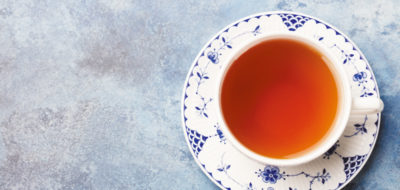 Cup of tea on a blue stone background. Top view