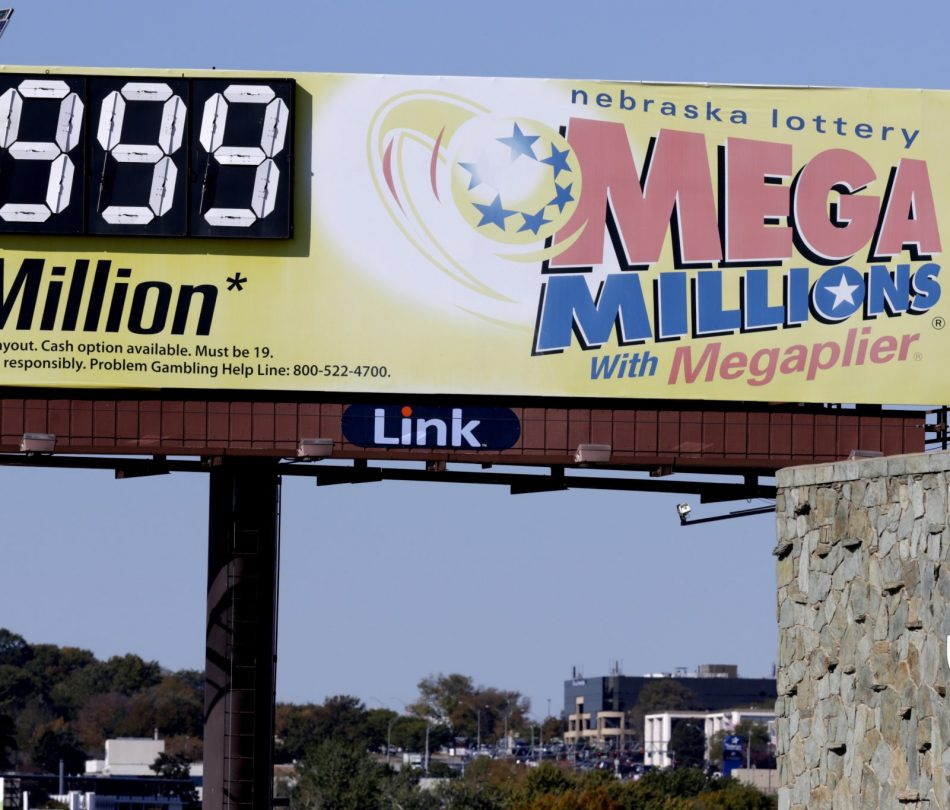 A Mega Millions billboard in Omaha, Neb., adjacent to a Sears store, shows 999 million, the maximum number it can show, ahead of the lottery draw, Friday, Oct. 19, 2018.  Lottery officials increased the grand prize just hours ahead of the Friday night drawing.  (AP Photo/Nati Harnik)