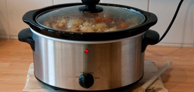 Slow cooker with a chicken casserole in