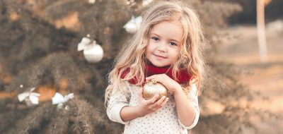 Smiling kid girl with christmas decorations